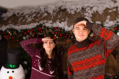 Couple Looking into Distance Outdoors in Winter