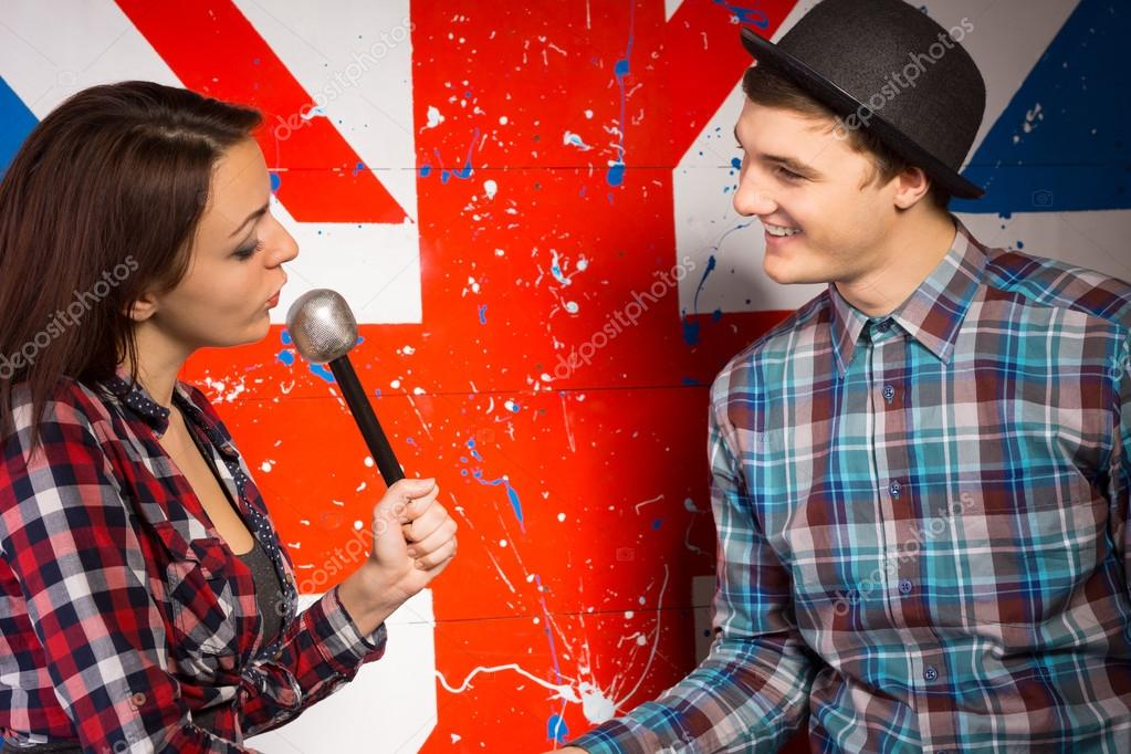 Woman with Microphone Talking To Man