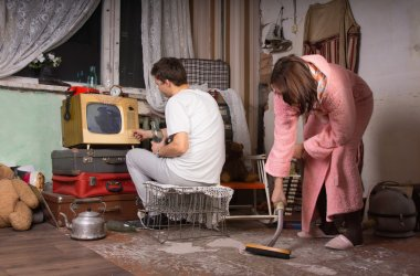 Young Couple Cleaning a Messy Room