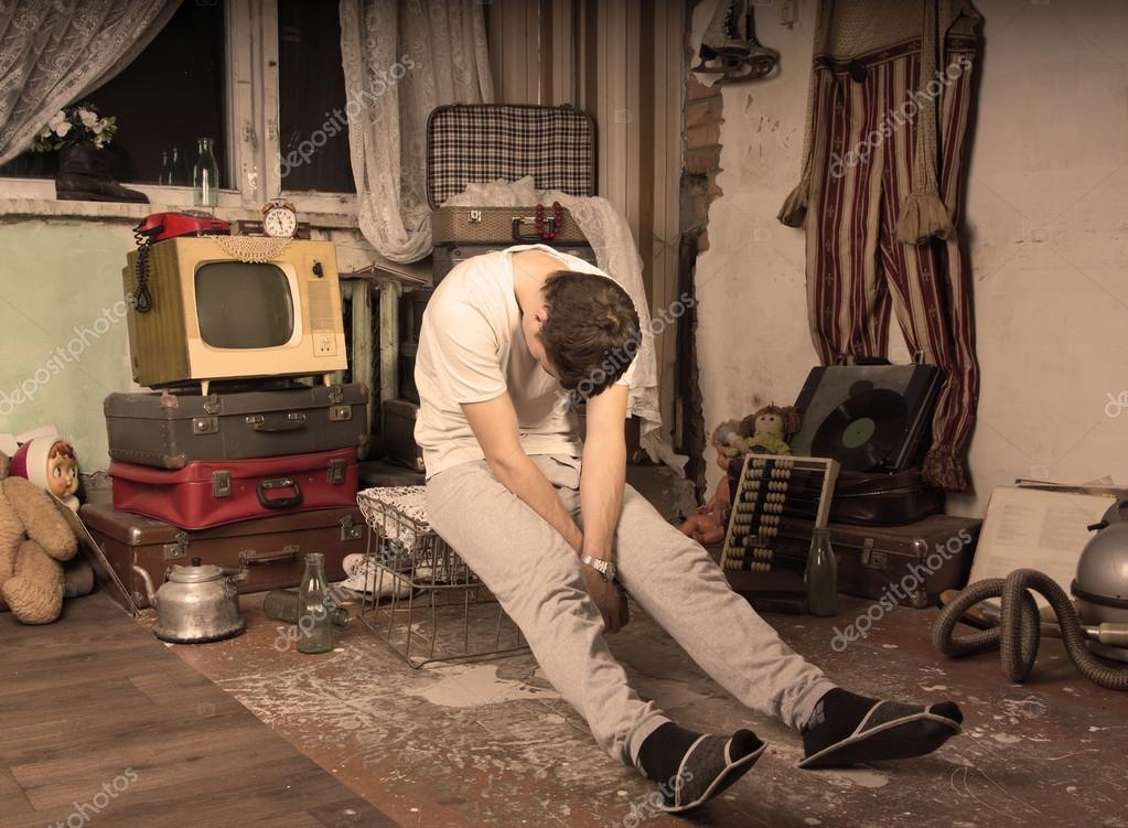 Young Man Taking a Nap at Messy Abandoned Room