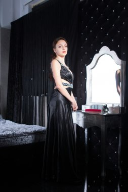 Smiling Woman in Elegant Black Dress at her Room