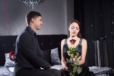 Lady with Rose Sitting at Bedroom with Boyfriend