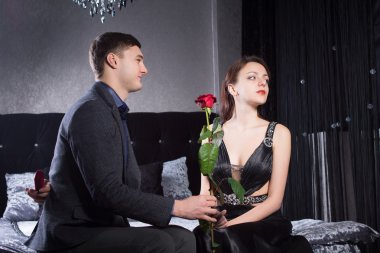 Gentleman Giving Rose Flower to Mad Girlfriend