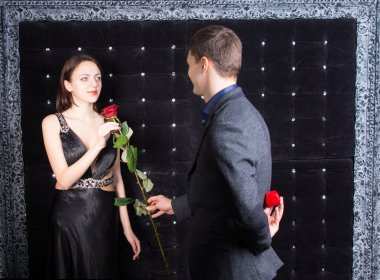 Young Man Giving a Rose to his Girlfriend