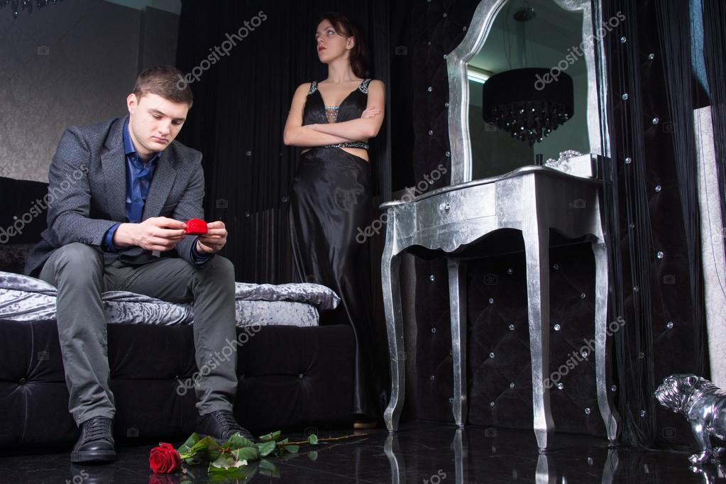 Formal Couple Having Argument with Roses on Ground