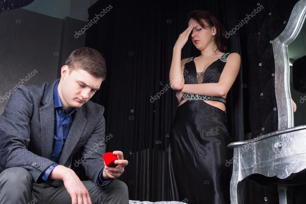 Dejected young man looking at the ring box