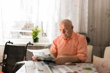 Sitting Happy Senior Man Reading Newspaper