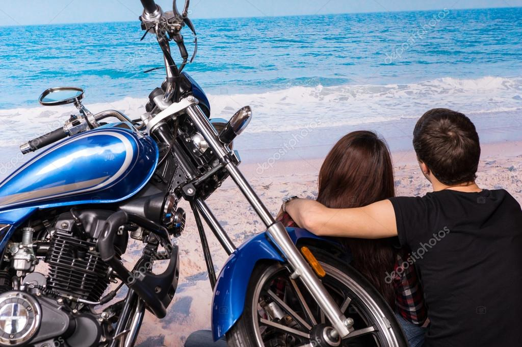 Couple on Sandy Beach with Motorcycle
