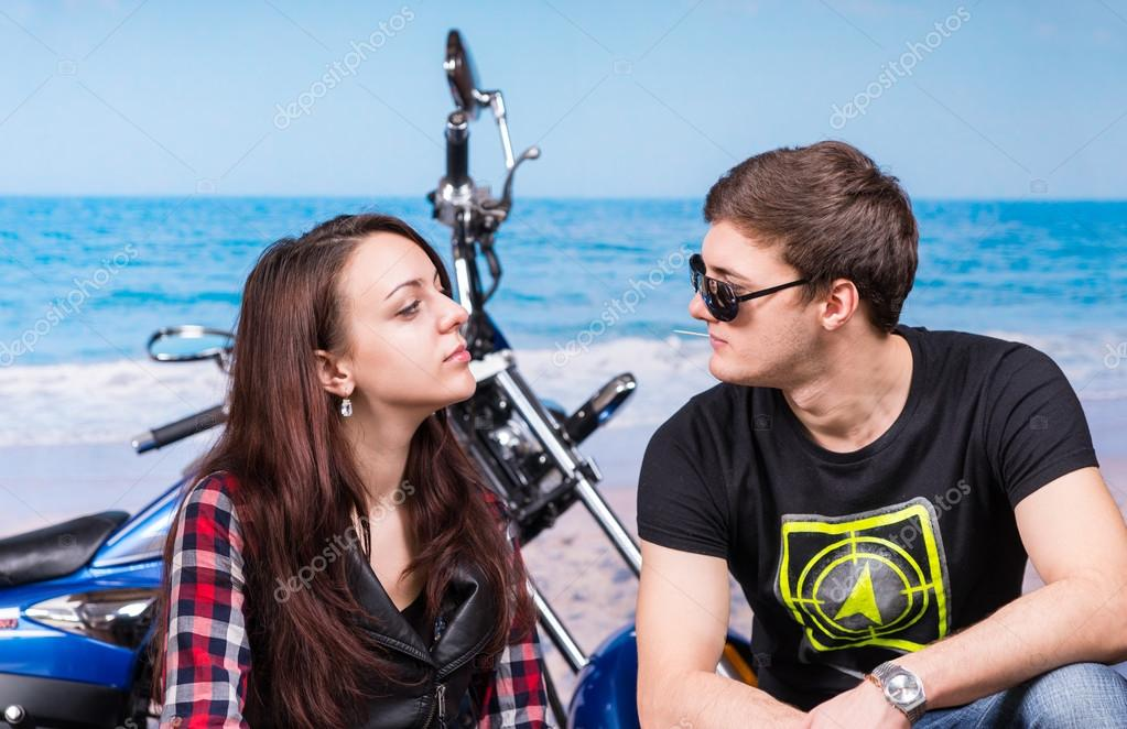 Serious Couple Facing Each Other at the Beach