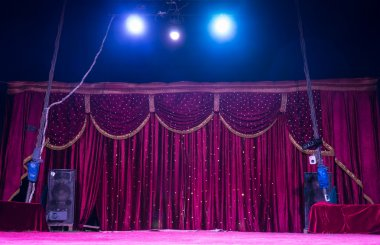 Colorful magenta curtains on a stage with spots