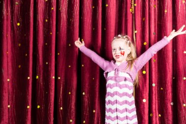 Pretty girl in pantomime costume on stage