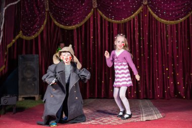 Children Dressed as Clowns Performing on Stage