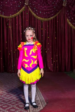 Adorable little girl in a pink and yellow costume