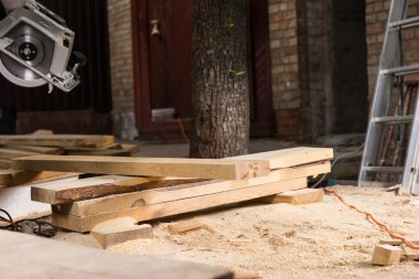 Wood Planks and Sawdust at Home Construction Site
