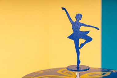 Ballerina Silhouette on Table in Colorful Room