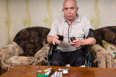 Senior Man Holding Healthy Juice and BP Apparatus