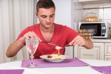 Hungry Young Man Eating Home Cooked Spaghetti Meal