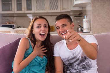 Young Couple Enjoying Comedy Film at Home