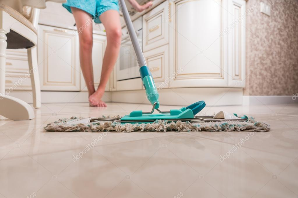 Young Woman Mopping Kitchen Floor — Stock Photo © Vaicheslav #84110958