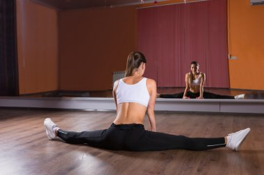 Young Woman Doing Splits in Dance Studio