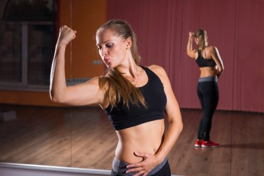 Athletic Woman Showing her Arm Muscles