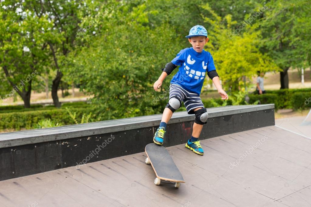 Young boy playing on a skateboard outdoors