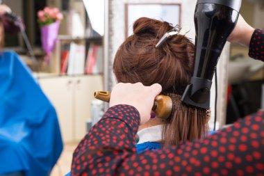 Brunette Woman Having Brown Hair Dried in Salon