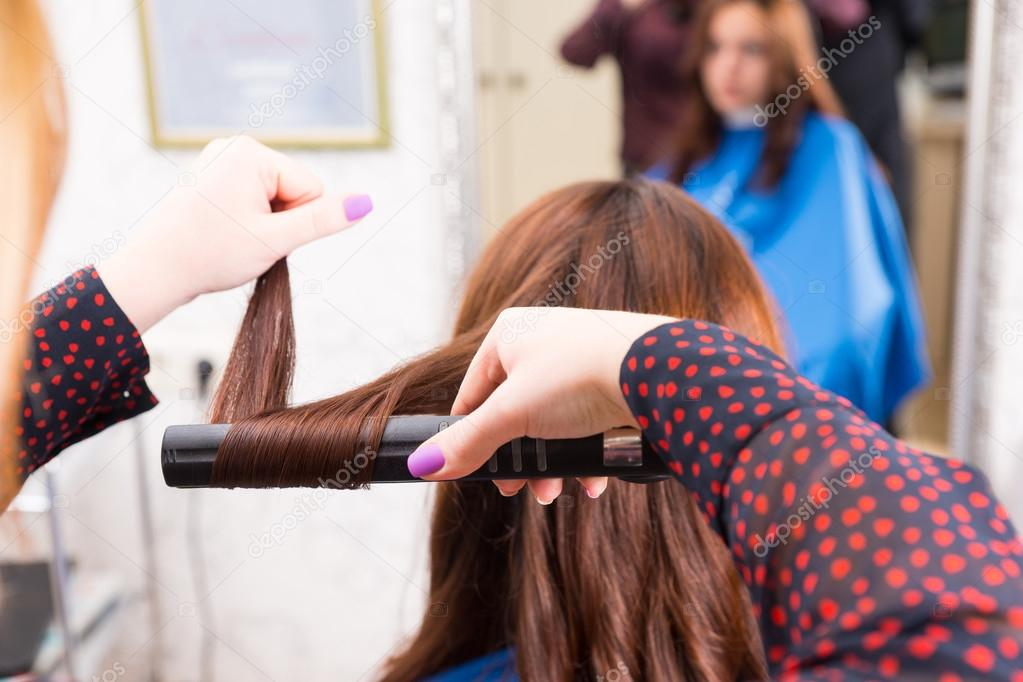 Stylist Using Flat Iron to Style Clients Hair