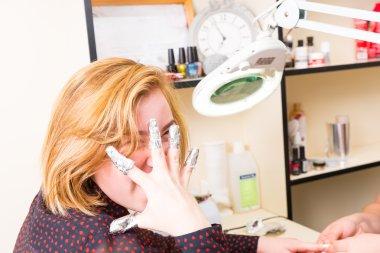 Playful Woman Getting Gel Manicure in Spa