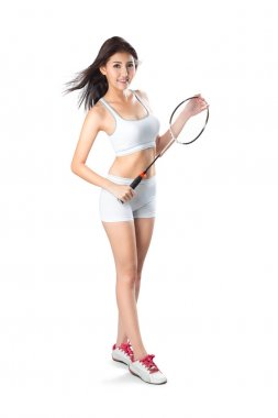 Young asian woman holding badminton racket,