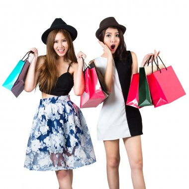 Beautiful asian teen girls carrying shopping bags