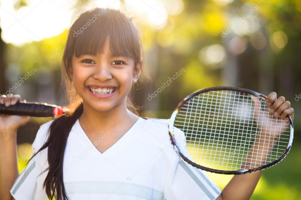 Little asian girl holding a badminton racket