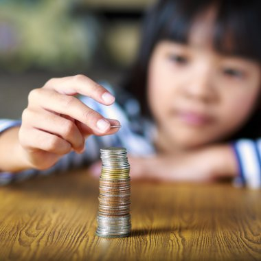 Little girl counts his coins