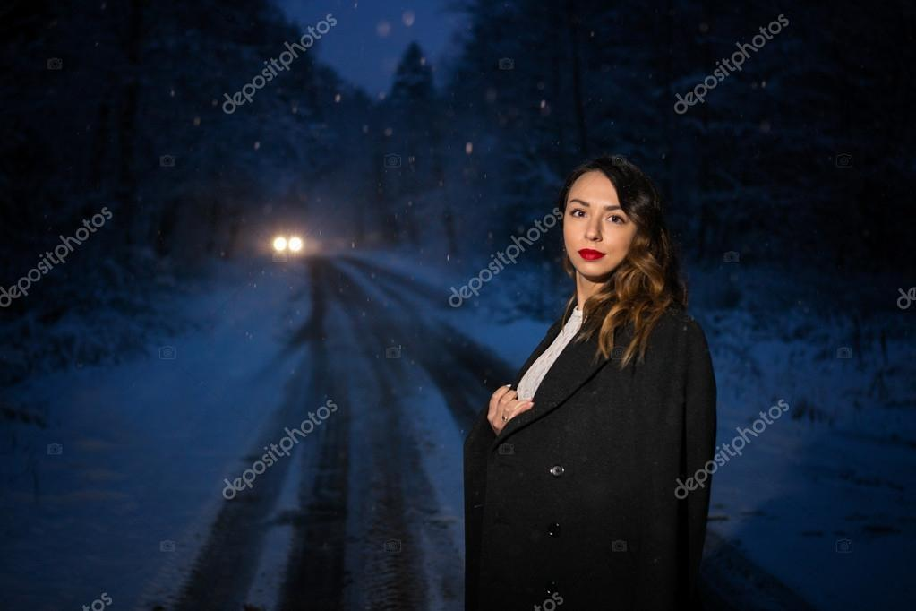 girl at night beside the road
