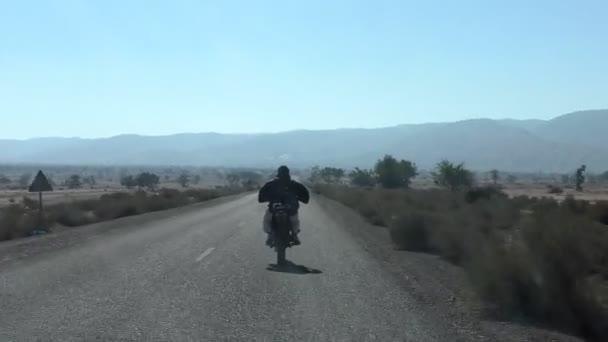 Man riding motorcycle in semi desert