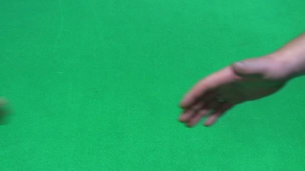 Handshake on green background
