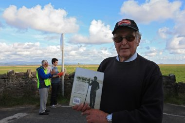 Cedric Robinson with his book at Morecambe Bay