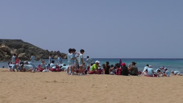 School children day out on the beach