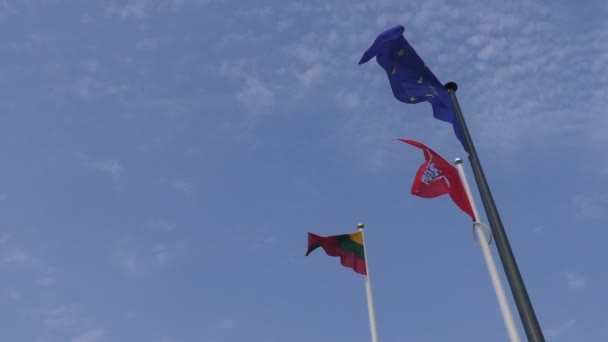 National Lithuanian and European Union EU flags waving in the sky