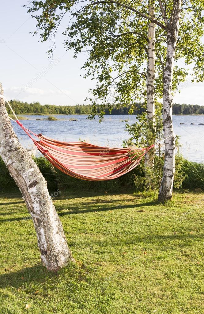 Red and orange striped hammock in sunshine