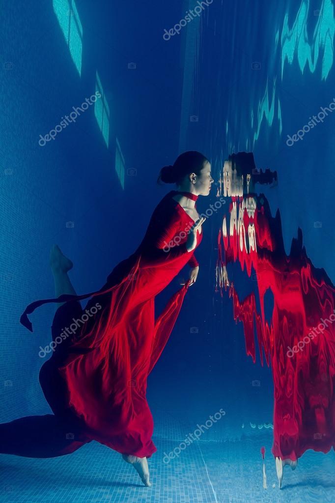 Red dress underwater