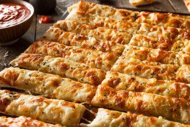 Homemade Cheesy Breadsticks with Marinara