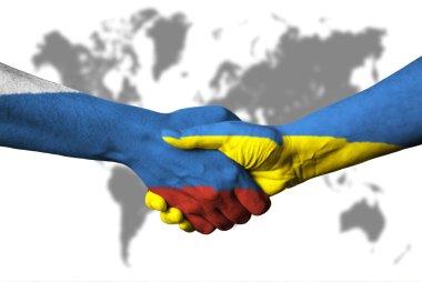 Russian flag and Ukraine flag across handshake.