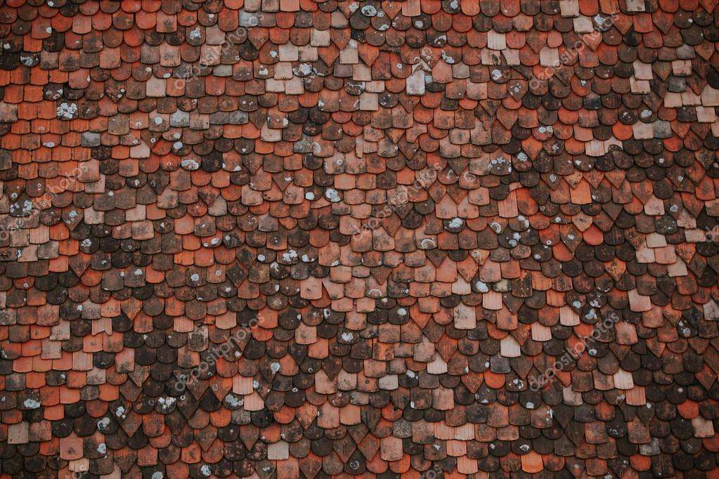 Colorful pattern of tiles on the roof. Medieval castle