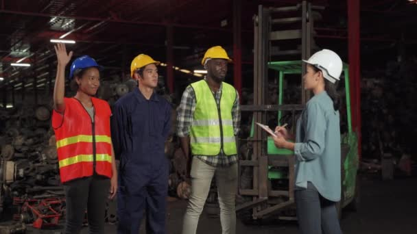 female engineer as a foreman Checking worker names and explain descriptions of night work, overtime work, female leaders