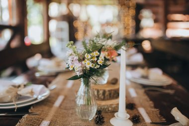 Decorations and wildflowers on festive table