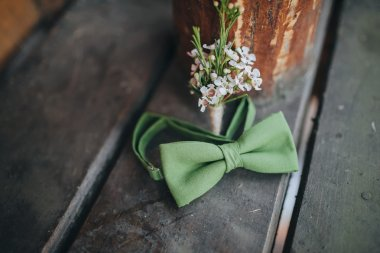 Green bow-tie and boutonniere