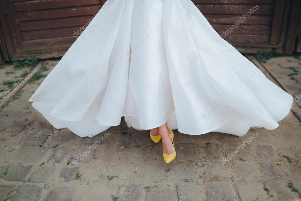 Close Up Legs Of Beautiful Bride In White Wedding Dress And Yellow Bridal  Shoes U2014 Photo By Hinhanni