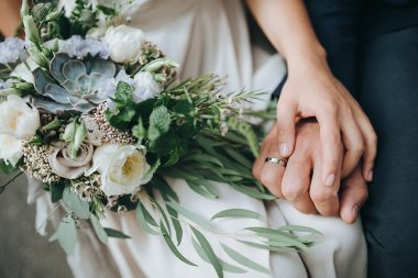 girl and guy holding bouquet