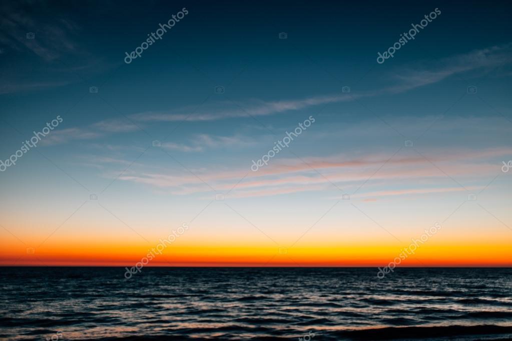 Defocused colorful sunset over sea. Summer background